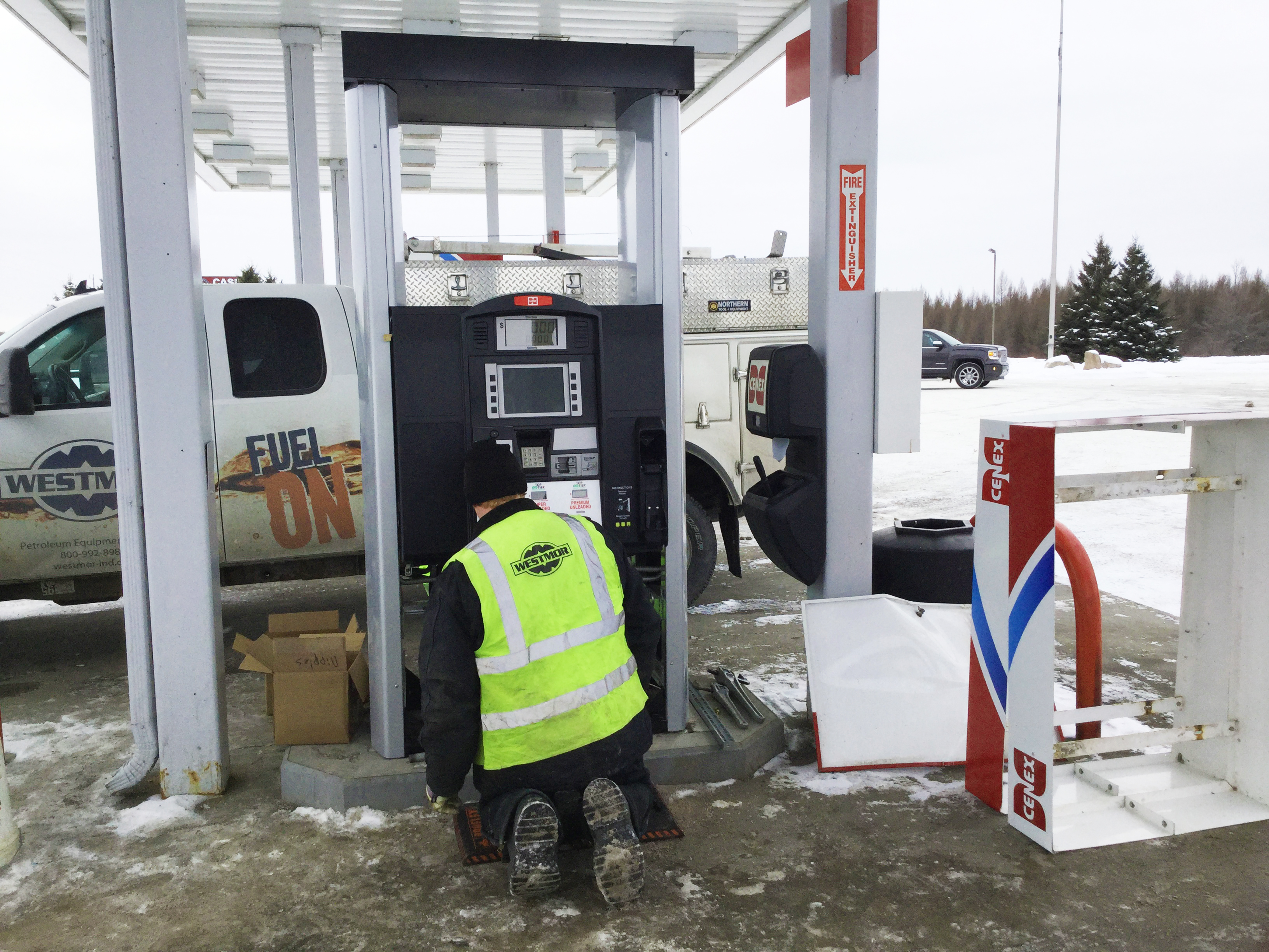Service tech installing new Encore 700S fuel dispenser.
