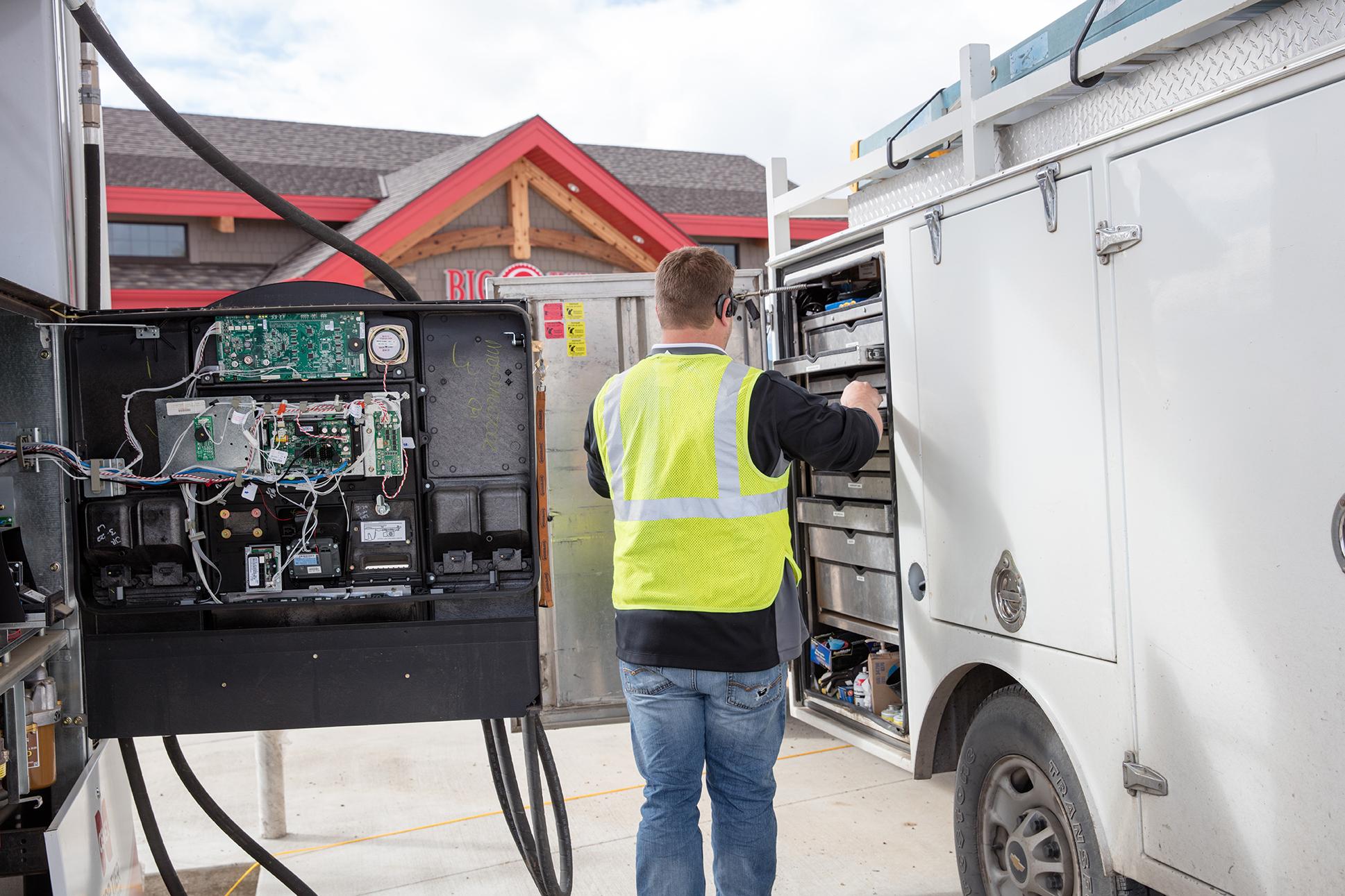 Westmor service technician fixing fuel dispenser at c-store.